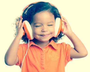 38053728 - small girl listening to music on her big headphones